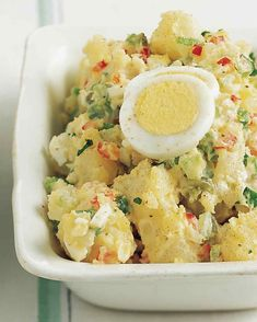 All-American Potato Salad--Our recipe is a variation on classic American-style potato salad. Warm potatoes are sprinkled with vinegar, dressed in mayonnaise, and mixed with hard-boiled eggs, celery, cornichons, and scallions.