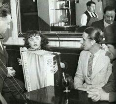 Edith Piaf in a Parisian cafe, ca. 1936. Photo by Jean-Gabriel Séruzier.
