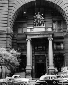 1957. The entrance of the old Equitable Building, Collins St. The building, a city landmark, is to be demolished. Now known as Colonial Mutual Life Building - on the corner of Collins and Elizabeth Streets - is a monument to fine building craftmanship and to the more lavish age of the 1890s.