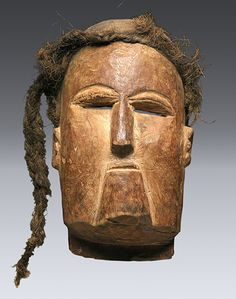 Mask, Attribution unknown, Mbeya region Wood, human hair, 25.4cm Collection of Frank and Liz Breuer QCC Art Gallery