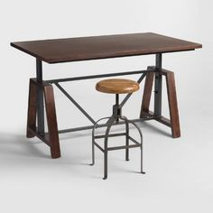 With an amply sized wooden surface, our adjustable-height table is a multifunctional workhorse that's just as suited as a desk in the home office as it is a casual dining solution. Use at its lowest height for a small-space dining table, adjust a little higher for a counter-level table, or set it at the highest height for a bar table.