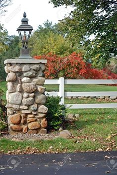 Stone pillar at the entrance of a private drive.