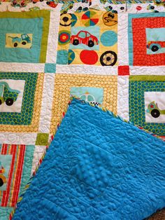 Handmade, Pieced and Quilted baby or toddler or lap quilt. Riley Blake Fabrics with cotton/blend batting and minky cuddle backing $100 plus shipping.  Sold.