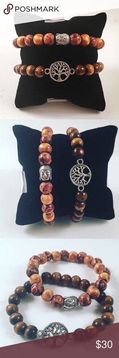 Set of two bracelets. Wood/Buddha/tree of life Set of two bracelets. Handmade . Never worn by anyone. Made out of wood. Buddha charm and tree of life are made out of tibetan silver. Boho/zen/hippie. Fits 6 to 7 inch wrist. Jewelry Bracelets