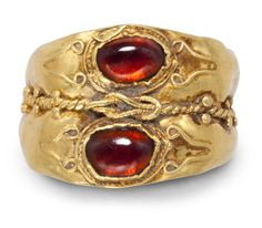 A Roman gold and garnet ring with a knot of Heraclex~ circa 2nd-3rd century AD.