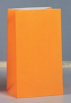 Pack of 12, orange paper party bags.  Great to match in with your colour scheme.  £2.99, order online at the Fuschia Boutique at www.fuschiadesigns.co.uk.
