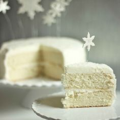 Dreaming of a White Christmas Cake - fluffy vanilla cake with whipped vanilla frosting & adorned with falling snowflakes