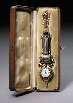 A FOUR-COLOR GOLD MOSS AGATE MINIATURE LOUIS XVI CLOCK AND BAROMETER  by Fabergé, workmaster August Holström, St. Petersburg, circa 1890, with scratched inventory number 43985 , in original velvet and silk lined wooden box, the cover stamped in Russian, 'Fabergé St. Petersburg Moscow' with Imperial warrant