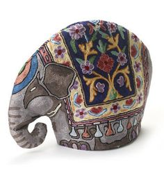I would love a tea cozy. My most used teapot is ...this is also an idea for something handmade. I love ones with fun fabrics, fun floral or animal motifs, and also the cable knit ones.