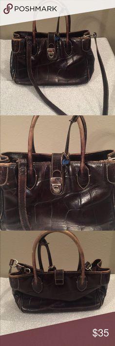 Dooney & Bourke Older style purse. In used condition. Dooney & Bourke Bags