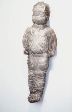 Untitled (doll wrapped in gray fabris) - May Wilson