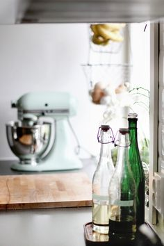 Here is an idea from Martha Stewart: pour all of your washing liquids into good looking (vintage) glass bottles. Having these bottles out on the countertop or on the sink's ledge will act as nice decor pieces (10).