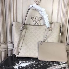 Buy LOUIS VUITTON Replica of top quality from China - Hina MM Mahina Leather is exclusively of top original order quality. Vuitton Bag, Louis Vuitton Handbags, Purses And Handbags, Louis Vuitton Monogram, Louis Vuitton Damier, Luxury Handbags, Designer Handbags, Cross Body Handbags, Authentic Louis Vuitton