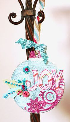 Joy_ornament...I don't usually like cd ornaments but this one is pretty cute. Might use this idea for the ornament party this year. Or maybe the kids could do that.
