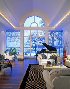 Living room perfect ceiling architecture bringing your eye out the windows to the magnificent lake view