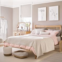 Pale pink bedroom with wooden furniture and woven accessories | housetohome.co.uk