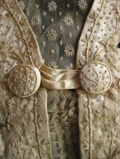 beautiful embroidery and lace detailing on an antique gown
