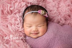 Smiley newborn girl pink and purple flokati swaddled pose | Bella Rose Portraits Southern California San Diego County newborn and baby photographer photography posing techniques