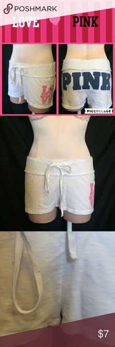 Victoria's Secret PINK sweat shorts Vs Pink White shorts with blue patch logo on back. Priced extremely low because there is a small stain (shown in 3rd photo) PINK Victoria's Secret Shorts