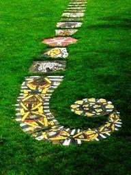looks fun--beautiful row of art in stepping stones