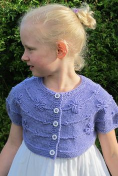 Versatile and classic with a touch of feminine texture. Choose a cardigan or bolero, short sleeved or long. This pattern is good for any time of the year. Knitting For Kids, Baby Knitting, Little Rose, Ravelry, Crochet Necklace, Daisy, Feminine, Pattern, Stitches