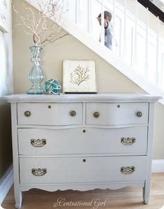 The perfect gray blue paint job on a restored dresser.