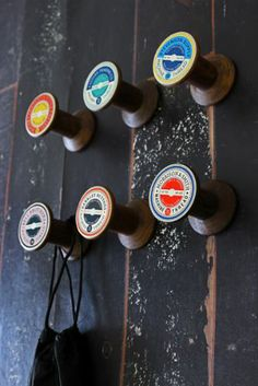 Set of Six Vintage Style Cotton Reel Hooks -- cute idea. It would be easy to do something like this rather than paying 55 pounds for it (ridiculous!)