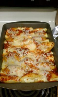 Delicious Stuffed Shells are the perfect easy, weeknight dinner. Jumbo pasta shells are stuffed with a smooth, creamy, cheesy filling flavored with fresh herbs and baked to absolute perfection. Easy Stuffed Shells, Ricotta Stuffed Shells, Stuffed Lasagna Shells, Barilla Stuffed Shells Recipe, Recipe For Stuffed Shells, Stuffed Pasta Recipes, Ground Beef Stuffed Shells, Sausage Stuffed Shells, Italian Stuffed Shells