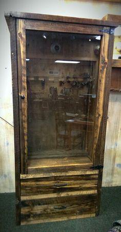 Rustic reclaimed wood gun case. So cool!