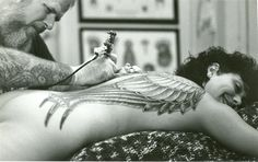 Bob Roberts of Spotlight Tattoo in L.A. inking Elayne Angels wings back in the 1980s!