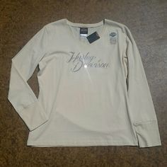 """NWT Harley-Davidson L/S Shirt New with tags,  Harley Davidson long sleeve, creme colored shirt with rhinestones. Size XL. 100% Cotton. V-neck. When laying flat, length 26.5"""", across the chest, 21"""", sleeve length 25"""". No rips, tears, flaws, or defects. Comes from a smoke free home. No trades, no holds. Harley-Davidson Tops Tees - Long Sleeve"""