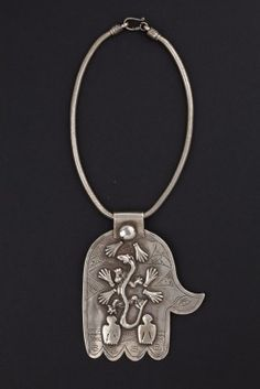 Khamsa pendant Morocco Beginning 1900 - Pendent with the shape of Fatima's hand or, Khasma ,formed by a silver plaque engraved and applied on a series of protective and scaramantiche symbols such as the salamander emblem of rebirth from the dead.