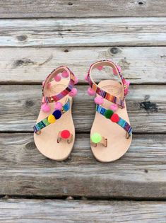 Excited to share the latest addition to my #etsy shop: Baby pom pom sandals, Greek baby boho sandals, Baby Greek sandals, summer shoes for girls, real leather, handmade, made in greece sandals, #shoes #children #greeksandals #girlsshoes #girlsflipflops #boho #leather http://etsy.me/2tzeXB9