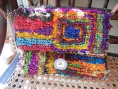 Locker Hooking purse with antler button by Charlotte Dey (image only) Fun colors and pattern.
