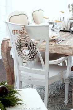 pinecone wreath on back of chair