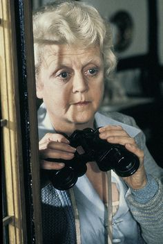 1980 Angela Lansbury as Miss Marple sleuthing in Agatha Christie's 'The Mirror Crack'd'.