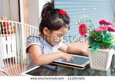 http://www.shutterstock.com/pic-111264524/stock-photo-girl-pushing-tablet-on-table-outdoor.html?src=FHlC6Ti-yAtPmROzRyiSdA-2-50