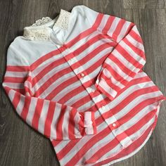 LC Lauren Conrad Striped Lace Button Up Blouse Top Coral and Ivory striped button up blouse. LC Lauren Conrad. Size XS 100% Polyester. One little stain on back. See photo. LC Lauren Conrad Tops Button Down Shirts