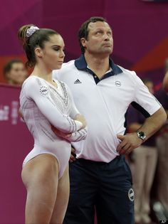 gymnast McKayla Maroney and her coach wait for the final scores after Romania's gymnast Sandra Raluca Izbasa's performance during the artistic gymnastics women's vault finals at the 2012 Summer Olympics, Sunday, Aug. in London. Gymnastics Pictures, Gymnastics Outfits, Gymnastics Girls, Gym Girls, Olympic Badminton, Olympic Games Sports, Olympic Gymnastics, Women Volleyball, Beach Volleyball