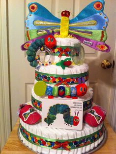 Very Hungry Caterpillar Diaper Cake. Check out Nuby.com or beautiful fun looking accessories to design your own diaper cakes.