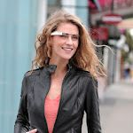 Google has revealed details of its research into augmented reality glasses.    It posted a brief introduction to Project Glass, photos and a concept video at its Google+ social network.    The images show a minimalist design with a microphone and partly-transparent video screen that places information over the view from the users' right eye.