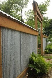 The Outer Fence Of Mike Pisaniu0027s Garden Is Constructed With Corrugated Steel  And Wooden Timbers.