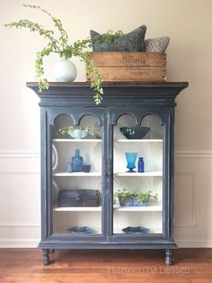 Blue chippy painted hutch-top turned bookcase by Thirteen79 Design.