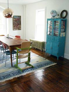 Love this farm house dining room redo! The blue hutch makes the room. And the wood floors...sigh:)