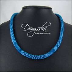 The necklace is made of czech seed beads Preciosa.    It is 48 cm (18.89 inches) long and it can be extended to 53 cm (20.86 inches) using an extender chain. The rope has approximately 0.8 cm (0.31 inches) in diameter.    Lobster clasp with extender chain.    Specification:    - color: blue  - length: 48 cm (18.89 inches), max. 53 cm (20.86 inches)  - diameter of the rope: 0.8 cm (0.31 inches)  - material: czech seed beads Preciosa  - material of components: base metal | Shop this product…