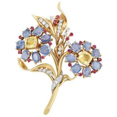 Gold, Platinum, Gem-Set and Diamond Flower Brooch, Ruser  2 cushion-shaped yellow sapphires ap. 3.50 cts., 14 cushion-shaped sapphires ap. 13.00 cts., 22 round diamonds ap. .90 ct., signed Ruser, c. 1945