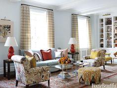 Colorful living room. Design: Christina Murphy. Photo: Jonny Valiant. housebeautiful.com. #ottoman #ikat #red #blue