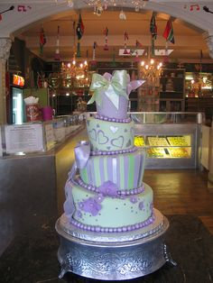 Love this! but are the colours too much? 4 tier mad hatter wedding cake in sage green & lilac by Charly's Bakery, via Flickr