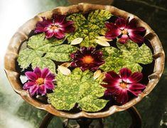 This bird bath contains actual flowers and leaves in it to create a gorgeous natural piece. Although the flowers and leaves in this photo appear to be real, you could always incorporate felt or plastic plants and flowers to prevent the water from rotting or becoming cloudy. If you were to use plastic plant pieces or flowers, they would surely last longer, too.