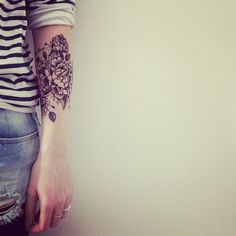 Forearm black and white roses tattoo